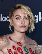 Paris Jackson styled her hair into a chignon with wavy tendrils cascading down one side of her face for the 2017 GLAAD Media Awards.