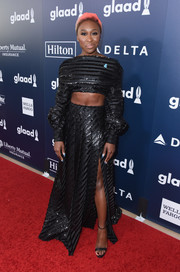 Cynthia Erivo paired her top with a matching high-slit maxi skirt.