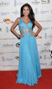 Joyce Giraud went for princess glamour with a sky blue flowing gown that featured an embellished waist.