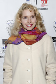Nellie McKay jazzed up her plain coat with a colorful scarf when she attended the Lucille Lortel Awards.