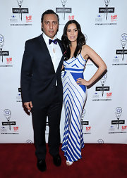Sheetal Sheth flaunted her curves in a figuring-hugging blue and white print dress at the Lucille Lortel Awards.