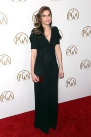 Amanda Peet channeled the '40s in a black Bottega Veneta gown with an embellished neckline and shoulders for the Producers Guild Awards.