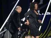 Oprah Winfrey added major sparkle to her look with a sequined black skirt at the Rock and Roll Hall of Fame Induction Ceremony.