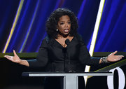 Oprah Winfrey went for classic elegance with this black wrap top at the Rock and Roll Hall of Fame Induction Ceremony.