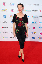Tina Arena kept it ultra feminine in a draped rose-print dress by Dolce & Gabbana at the ARIA Awards.