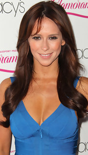 Jennifer Love Hewitt's locks were long and lovely at Macy's 29th Annual Passport event. Jennifer's glamorous 'do can be recreated by curling strands with a large-barreled curling iron then brushing through tresses to create lots of smoothness.