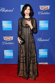 Sally Hawkins completed her look with an embroidered leather clutch, also by Dior.