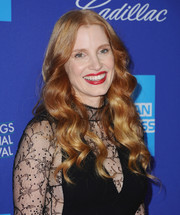 Jessica Chastain went for a vibrant red lip while keeping the rest of her beauty look understated.