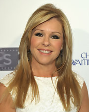 Leigh Anne Tuohy looked radiant with straight long locks. She added a little lift to her look with added volume at the root.