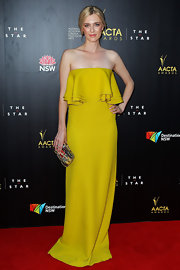 Gracie Otto was the citrine queen on the red carpet in this rich yellow gown with bodice of layered ruffles.