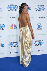 Olivia looked like a Grecian princess in this draped white satin gown with an open back.