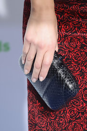 Maria Menounos grabbed a black snakeskin clutch before heading out to the 2012 American Giving Awards.
