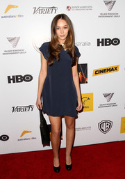 Alycia Debnam-Carey was low-key in a plain blue mini dress at the Australians in Film Awards Gala.