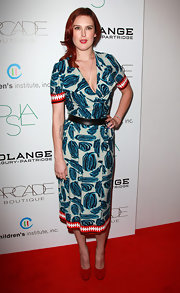 Rumer Willis showed off her fresh red locks with a vibrant print dress at the Autumn Party.