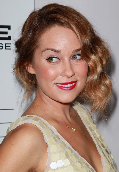Instead of going with a classic red lipstick, Lauren Conrad opted for a bold fuchsia shade at the 2nd Annual Autumn Party.