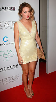 Lauren Conrad wore a cream v-neck cocktail dress with large paillettes for the Autumn Party.