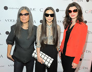 Monica Botkier wore her hair in layered curls for the Vogue Eyewear Launch Party.