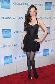 Rose McGowan opted for a monochromatic look in black flirty heels. She paired the ankle strap heels with sheer tights and an adorable ruffled halter dress.