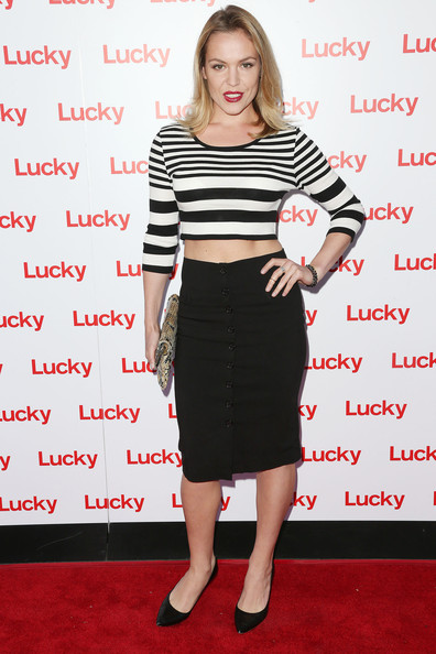 Agnes Bruckner topped off her mod-inspired look with this black pencil skirt featuring a row of buttons on the front.