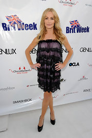 Taylor Armstrong attended the Year of Fashion Awards in Brittan wearing a tulle embellished black and purple dress.