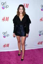 Ashley Benson paired her top with a navy mini skirt, also by Paris Georgia.