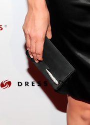 Jodi showed off her satin clutch, which was encrusted with gemstones on the flap.