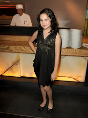 Bailee Madison teamed up her dress with a pair of bejeweled ballet flats.
