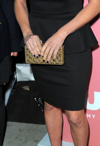 Brittany paired her black strapless dress with a gold box clutch.