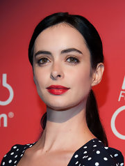 Krysten Ritter's jet-black hair looked cool and stylish when styled into a low ponytail.