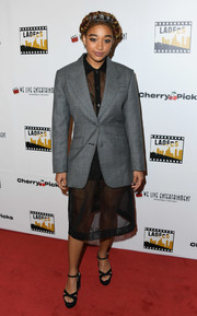 Amandla Stenberg styled her look with black cross-strap platforms by Miu Miu.