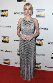 Lucy Boynton glammed up in a fringed silver gown by Prada for the Los Angeles Online Film Critics Society Awards.