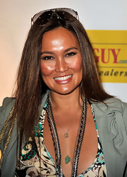 Tia Carrere sported a silky straight hairstyle at the PacSun Pipeline to a Cure event.