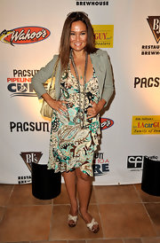 Tia Carrere completed her summer-chic look with a pair of white cross-strap platform sandals.