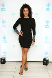 Hannah Bronfman cut a shapely silhouette in a body-con black sweater dress with studded cuffs at the Shorty Social Good Awards.