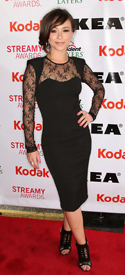 Danielle showed off her sexy side in this knee-length black dress with lace insets. She stole the carpet in this sultry look.