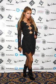 Paris Hilton chose heeled ankle boots to go with her black look for the 2nd Annual Women In Art Benefit.