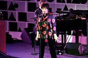 Liza Minnelli performed wearing a usual top and slacks ensemble, this time a print satin blouse, at the amfAR gala in New York.