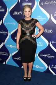 Amy Poehler kept it classy in a black and nude geometric-bodice sheath dress by Tadashi Shoji at the unite4:humanity event.