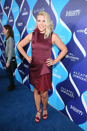 Busy Philipps matched her frock with a fun and chic pair of burgundy strappy sandals.
