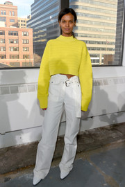 Liya Kebede teamed her top with baggy white trousers.
