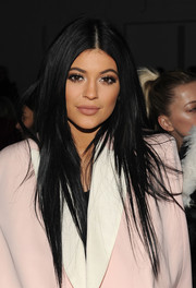 Kylie Jenner attended the 3.1 Phillip Lim Fall 2015 show wearing her hair in a straight layered cut.