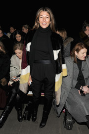 Nina Garcia completed her cold-weather ensemble with a pair of black knee-high boots.