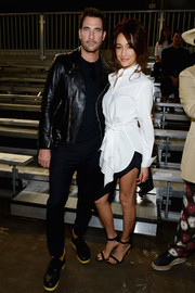 Maggie Q looked stylish at the 3.1 Phillip Lim fashion show in a white button-down with drape detailing.
