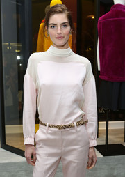 Hilary Rhoda styled her monochromatic ensemble with a leopard-print belt for the 3.1 Phillip Lim NYC flagship store opening.