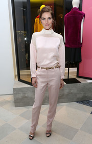 Hilary Rhoda went for a monochromatic finish with baby-pink slacks.