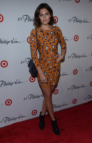 Alyssa Miller paired her print dress with black ankle boots for an edgy finish.