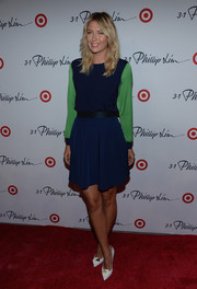 Maria Sharapova looked modest in a long-sleeve blue and green dress at the 3.1 Phillip Lim for Target launch event.