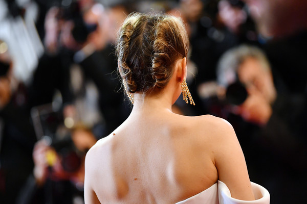 Marion Cotillard attended the Cannes Film Festival screening of '3 Faces' wearing her hair in a double French twist.