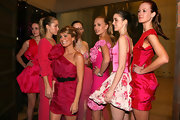 Natalie Bassingthwaighte looked cute wearing a pink ruched dress as she posed with models at the 30 Days of Fashion and Beauty event.