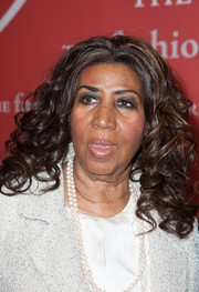 Aretha Franklin wore her hair in ultra-feminine curls when she attended the Annual Night of Stars.